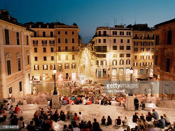 tourist's sitting in piazza di spagna at dusk - yeowell stock pictures, royalty-free photos & images