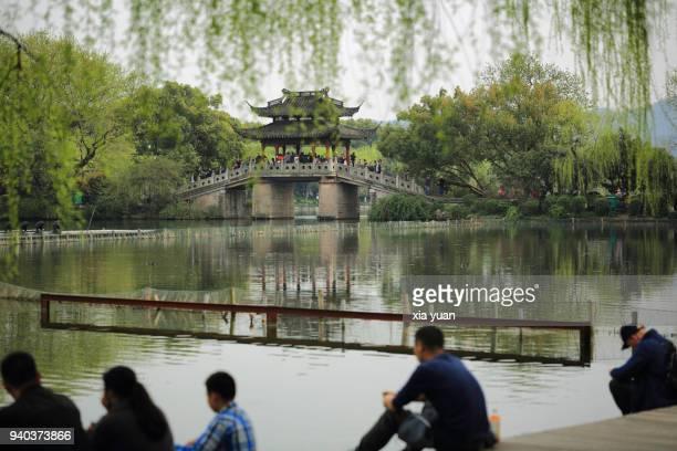 Tourists sitting side of the West Lake,Hangzhou,China
