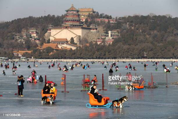 Tourists skate on the summer palace ice rink, Beijing, China, January 4, 2020. - PHOTOGRAPH BY Costfoto / Barcroft Media