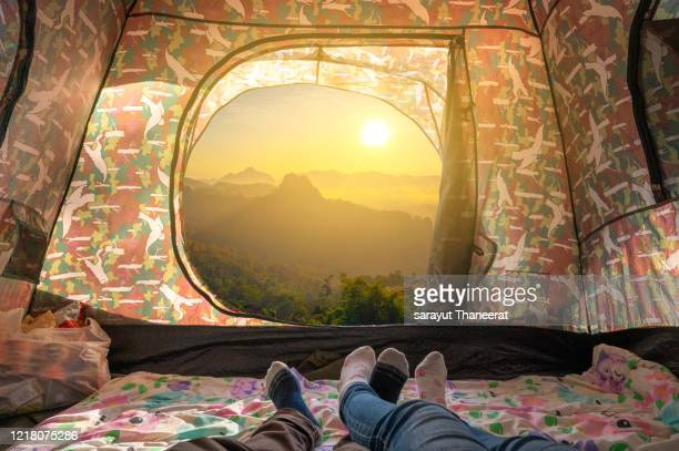 tourists sleep in holiday camping with views in the morning nature. - open backpack stock pictures, royalty-free photos & images