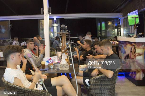 Tourists smoke hookah pipes in a bar in Hersonissos, on the island of Crete, Greece, on Tuesday, Sept. 24, 2019. Like Crete, Europes other tourist...