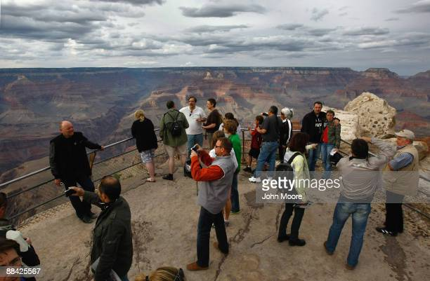 Tourists snap photos at Mather Point June 10 2009 in the Grand Canyon National Park Arizona Work began this week with federal stimulus money to...