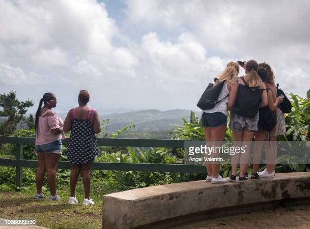 Tourists snap photos of the El Yunque Rain Forest on September 19 2018 in Rio Grande Puerto Rico Parts of the popular destination have been reopened...