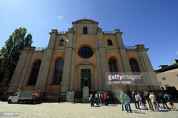 Tourists stand by the Cathedral known as Storkyrkan situated near the Royal Castle in Stockholm on May 24 2010 Many tourists paid a visit to the...