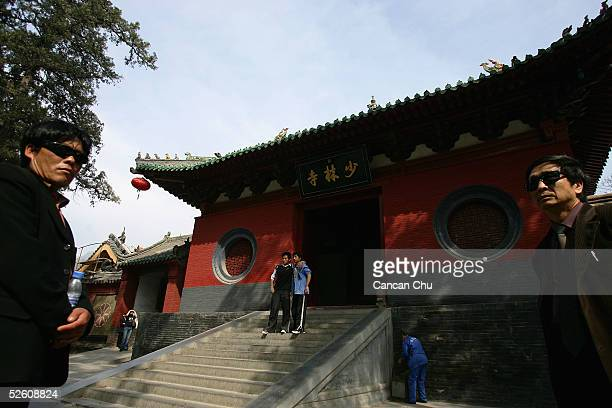 Tourists stand in front of the main gate of the Shaolin Temple April 7 2005 in Dengfeng Henan Province China Shaolin Temple was built in AD 495 in...