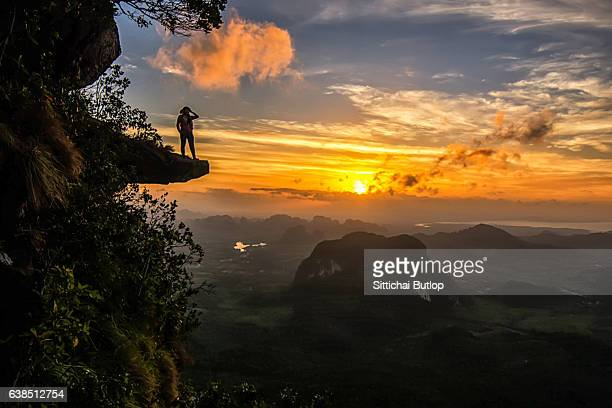 Tourists stand in view of khao ngon nak on February 28,2016 in Krabi,Thailand.