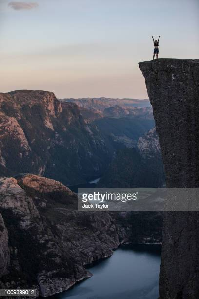 Tourists stand on top of Preikestolen ahead of The 'Mission Impossible Fallout' Pulpit Rock Norway Screening on August 01 2018 in Forsand Norway