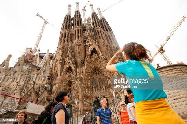 Tourists stand outside the Sagrada Familia closed for visits during a general strike in Barcelona called by Catalan unions on October 3 2017 Large...