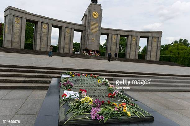 Tourists standing at the Soviet War Memorial on on the Stra��e des 17. Juni in Berlin , Germany . Throughout Europe, the 70th anniversary of the end...