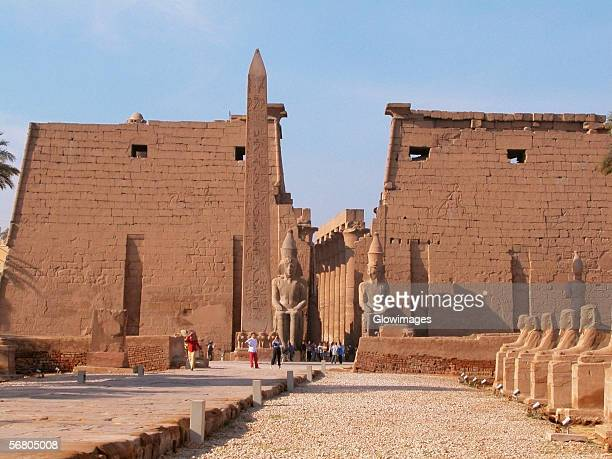 Tourists standing near a obelisk, Temple Of Luxor, Luxor, Egypt