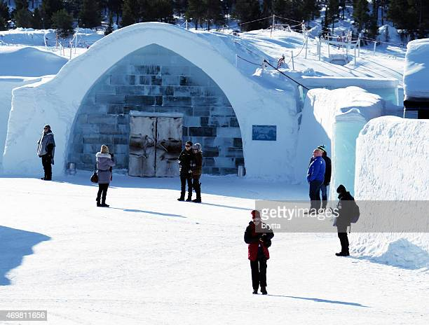 Tourists standing near  entrance of ice hotel in Jukkasjarvi,Sweden