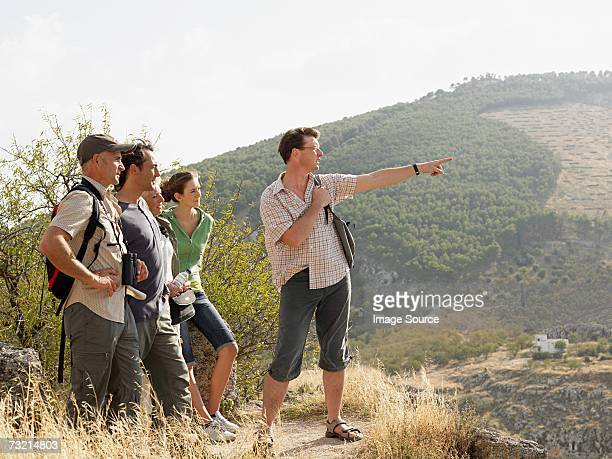 Tourists standing on a mountain