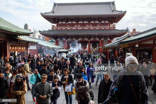 Tourists stroll around the grounds of Sensoji buddhist temple on January 19 2018 in Tokyo Japan Sensoji is Tokyo's oldest temple dating back to 628...