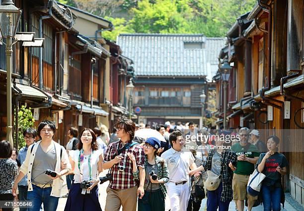 Tourists stroll the old town of Kanazawa on April 29 2015 in Kanazawa Ishikawa Japan Hokuriku region including Kanazawa expect more tourists during...