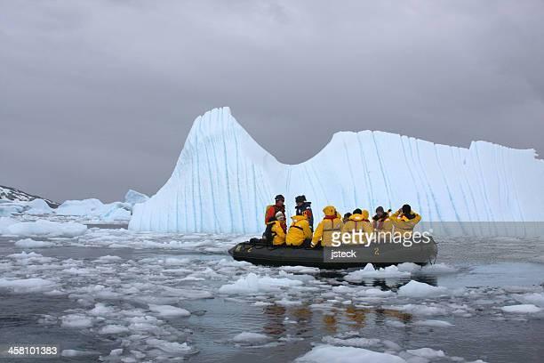 Tourists Studying the Icebergs in Cierva Cove Antarctica