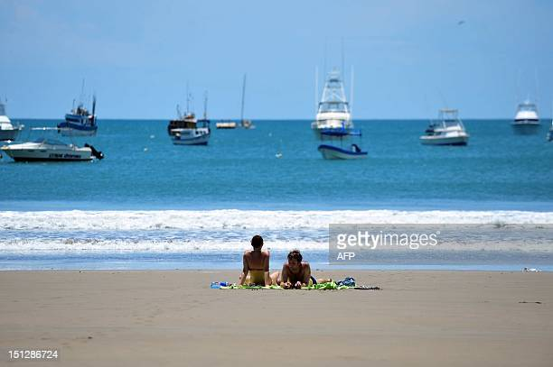 Tourists sunbath in San Juan del Sur beach 140 km from Managua during the tsunami alert issued in the Pacific coast following the earthquake that...
