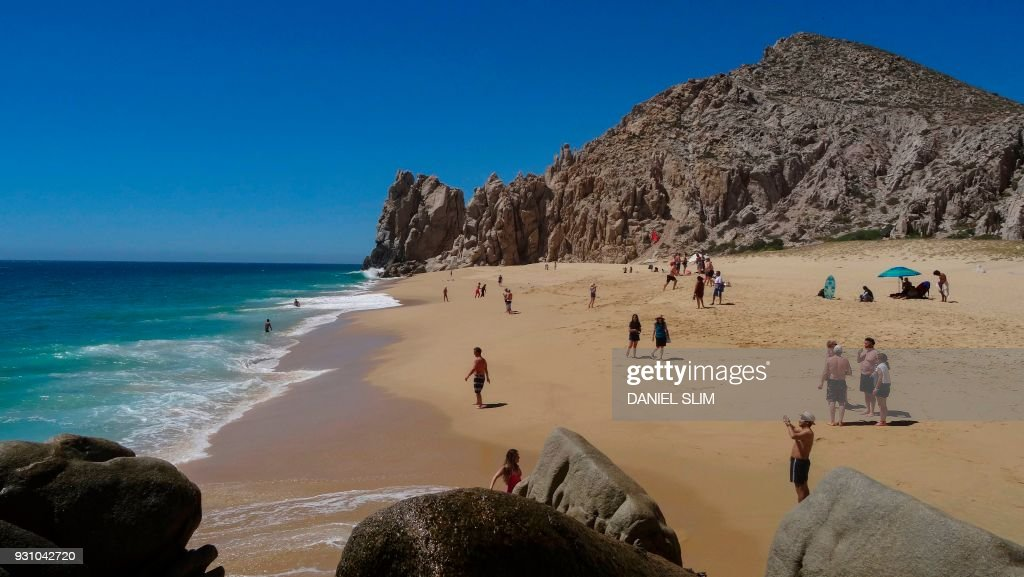 Tourists Sunbathe At The Love Beach In Los Cabos Baja California Sur State