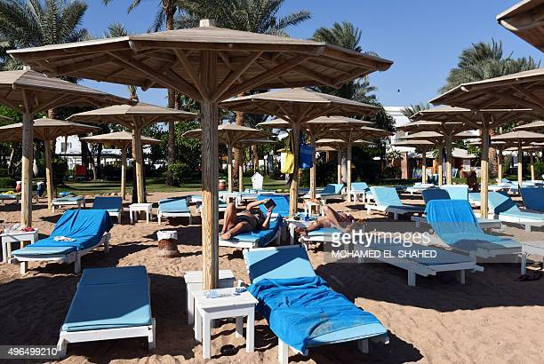 Tourists sunbathe on a beach in Egypt's Red Sea resort of Sharm ElSheikh on November 10 2015 As visitors stranded after the crash of a Russian...