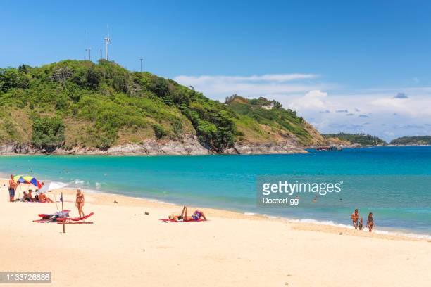 Tourists sunbathing at Nia Harn Beach in Suumer, Phuket, Thailand