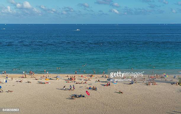tourists sunbathing on beach - spring break stock pictures, royalty-free photos & images