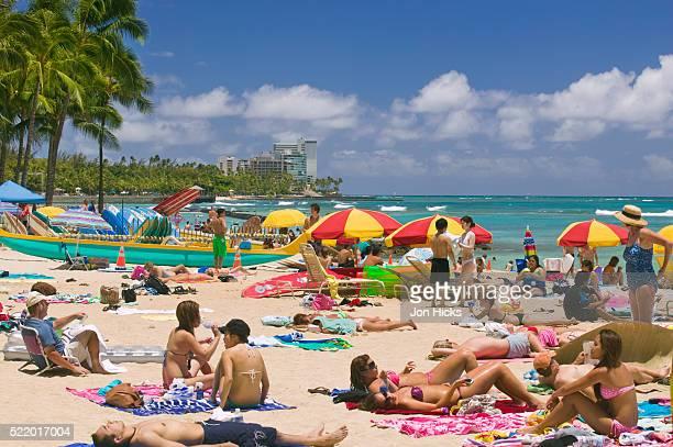Tourists Sunbathing on Waikiki Beach
