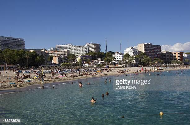 Tourists swim and sunbath at Magaluf's beach in Calvia on Mallorca Island on August 10 2015 AFP PHOTO/ JAIME REINA