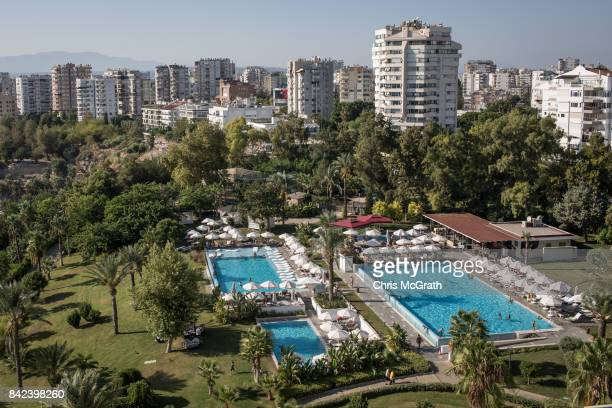 Tourists swim at a hotel pool complex on September 2 2017 in Antalya Turkey Turkey's tourism industry spiraled into crisis in 2016 after a year of...