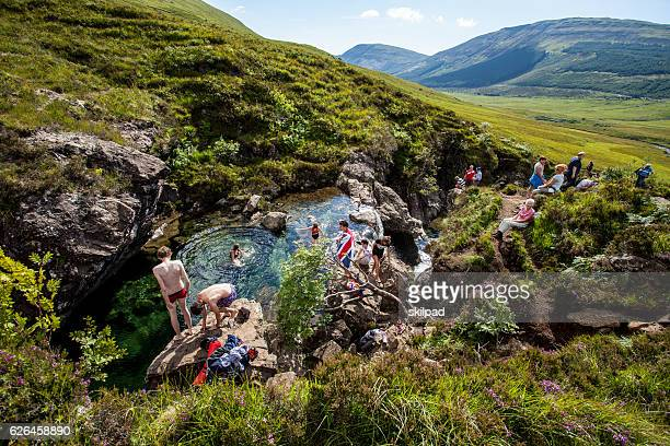 Tourists swim in stream on Skye, Scotland