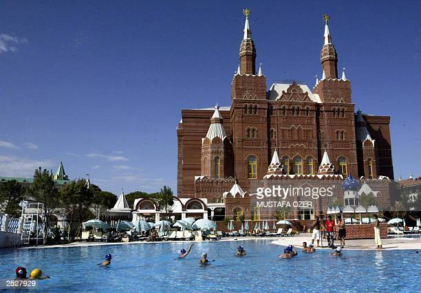 Tourists swimming in the pool at the Kremlin Palace Hotel in Antalya Turkey 11 September 2003 in front of an exact replica of the Moscow History...
