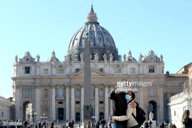 Tourists take a selfie at St Peter's Square on March 05 2020 in Rome Italy