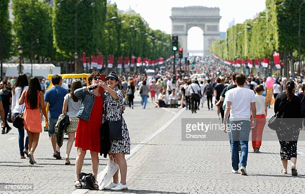 Tourists take a selfie on the Champs Elysees avenue made in to a pedestrian walkway on June 07 2015 in Paris France The most famous avenue in the...
