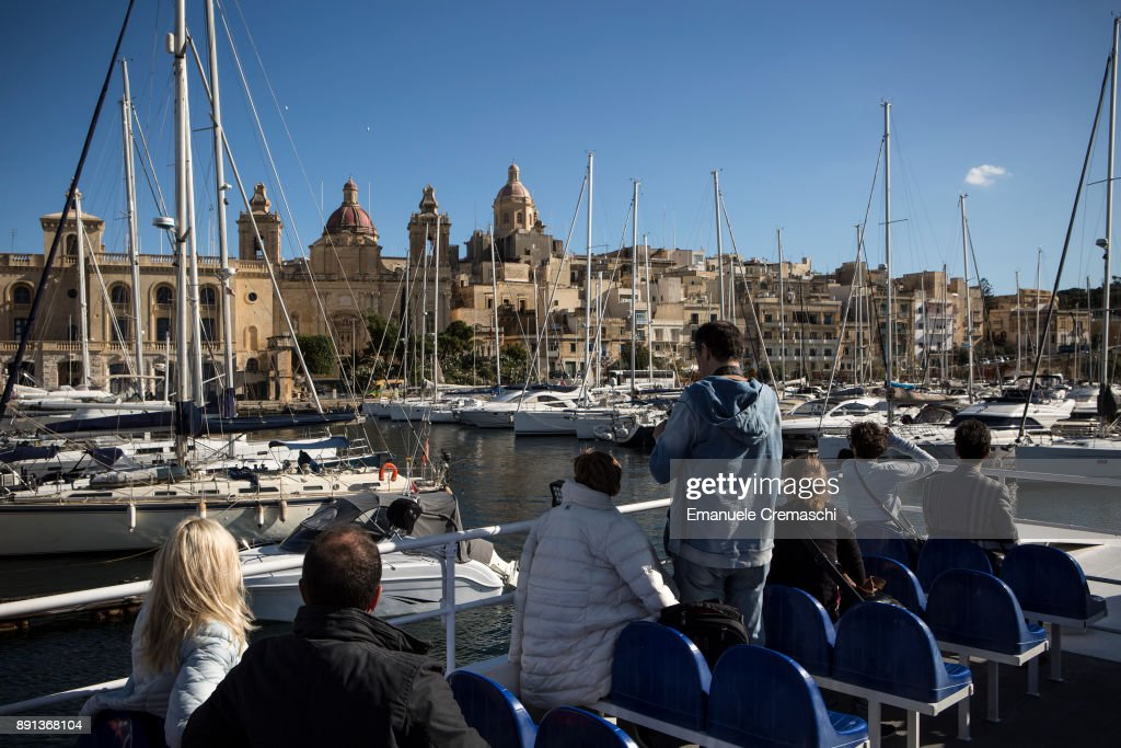 Tourists take a tour aboard a ferry sailing to the south side of Valletta's Grand Harbour on December 7, 2017 in Vittoriosa, Malta. Valletta, a fortified town that dates back to the 16th century, is the southernmost capital of Europe and a UNESCO World Heritage Site: together with all the Maltese islands, it will be hosting the title of European Capital of Culture in 2018.