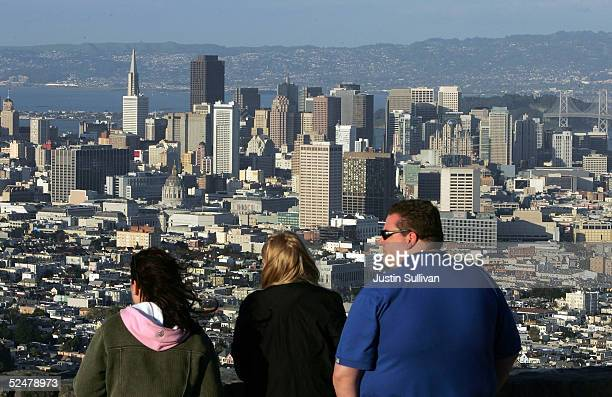 Tourists take in a view of downtown San Francisco from Twin Peaks March 25 2005 in San Francisco California San Francisco's 49Mile Scenic Drive was...