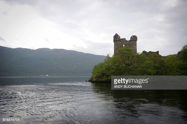 Tourists take in the sights as they travel by cruise boat on Loch Ness in the Scottish Highlands Scotland on June 10 2018