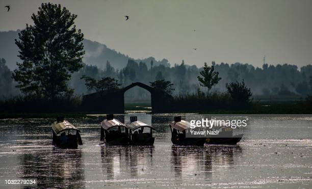 Tourists take joyride in Shikara boats on Dal lake on September 12 2018 in Srinagar the summer capital of Indian administered Kashmir India Kashmir...