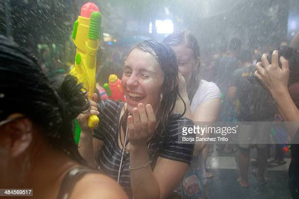 Tourists take part in a water fight during the Songkran water festival in Silom road on April 13 2014 in Bangkok Thailand The Songkran festival marks...