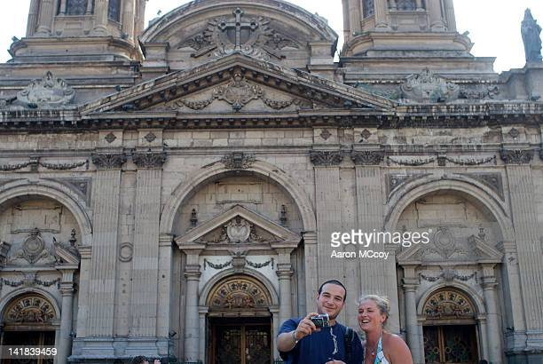 Tourists take photo next to cathedral in Santiago, Chile