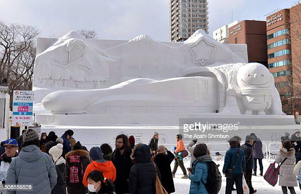 Tourists take photographs of a snow statue as the 67th Sapporo Snow Festival begins on February 5 2016 in Sapporo Hokkaido Japan The Sapporo Snow...
