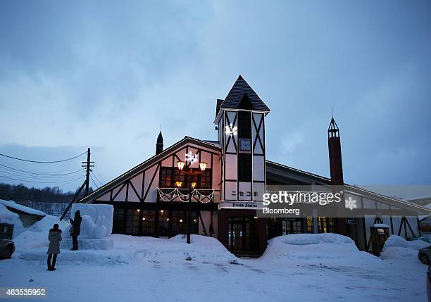 Tourists take photographs outside Niseko station in Kutchan Hokkaido Japan on Saturday Feb 14 2015 Japan had a record number of foreign visitors in...