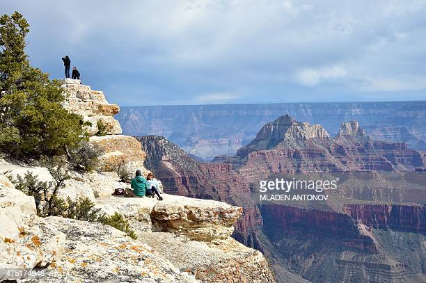 Tourists take photos from the North Rim of the Grand Canyon on May 18 2015 AFP PHOTO/MLADEN ANTONOV