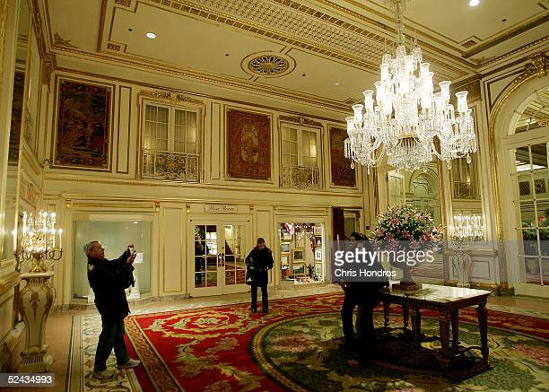 Tourists take photos in the foyer of the Plaza Hotel March 16 2005 in New York City The legendary Plaza Hotel which opened in 1907 and hosted New...