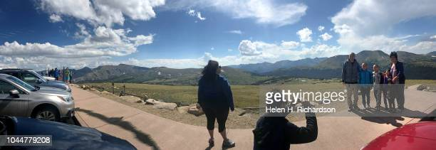 Tourists take photos spectacular mountainous setting at the Gore Range overlook in Rocky Mountain National Park on August 5 in Estes Park Colorado...
