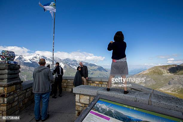 Tourists take pictures at the Edelweissspitze the highest point of the Grossglockner high alpine road on September 08 near Zell am See Austria The...
