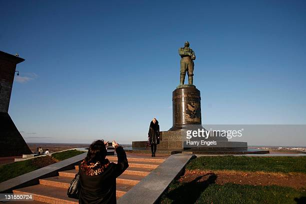 Tourists take pictures in front of a statue on November 5, 2011 in Nizhny Novgorod, Russia. Nizhny Novgorod is one of thirteen cities proposed as a...