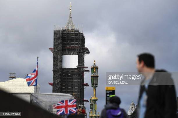 Tourists take pictures near Big Ben during ongoing renovations to the Tower and the Houses of Parliament, in central London on January 17, 2020.