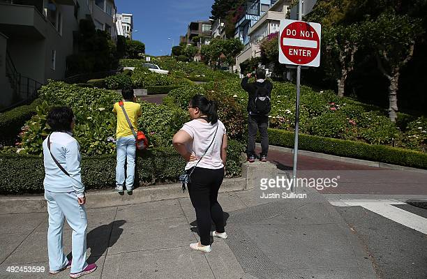 Tourists take pictures of Lombard Street on May 20 2014 in San Francisco California The San Francisco Municipal Transportation Agency Board of...