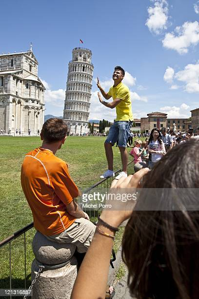 Tourists take pictures of the leaning tower on July 18, 2011 in Pisa, Italy.