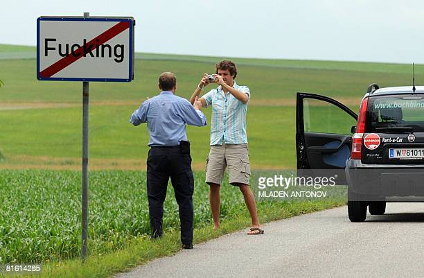 Tourists take pictures of the road sign of the village of Fucking, some 35 km North of Salzburg, on June 18, 2008. Due to its name, the village...