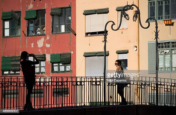 Tourists take pictures on September 24 2015 in Girona Spain Over 5 million Catalans will be voting in Parliamentary elections on September 27 with...