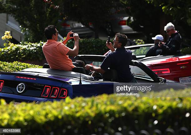 Tourists take pictures while driving down Lombard Street on May 20, 2014 in San Francisco, California. The San Francisco Municipal Transportation...